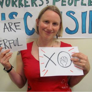 Clare Bayard holding signs